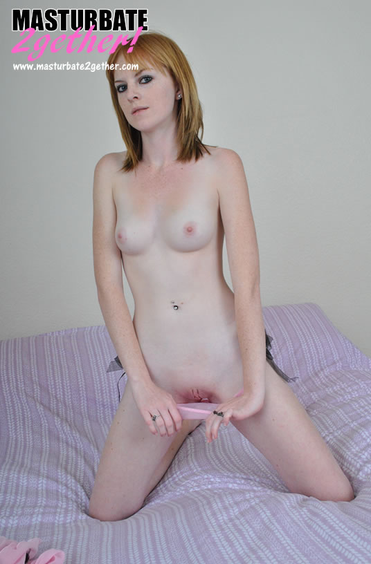 Teen_Ginger pulling her pink knickers down and flashing her pretty twat.
